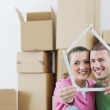 Royalty-Free Stock Photo: Young couple moving in new house