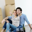 Stock Photo: Young couple moving in new house
