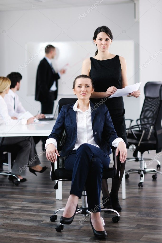 Group of happy young business in a meeting at office  Stock Photo #10705753