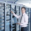 Businessman with laptop in network server room — Stock Photo #7964983