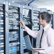 Businessman with laptop in network server room — Stock Photo #7964984