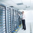 Young it engeneer in datacenter server room — Stock Photo #7964989