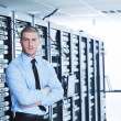 Young it engeneer in datacenter server room — Stock Photo #7965020