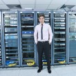 Young it engeneer in datacenter server room -  
