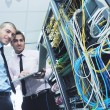 It enineers in network server room — Stock Photo #7965110