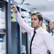 It enineers in network server room — Stock Photo #7965116
