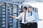 It enineers in network server room — Foto de Stock