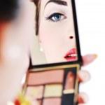Beautiful young woman applying makeup — Stock Photo #7992321