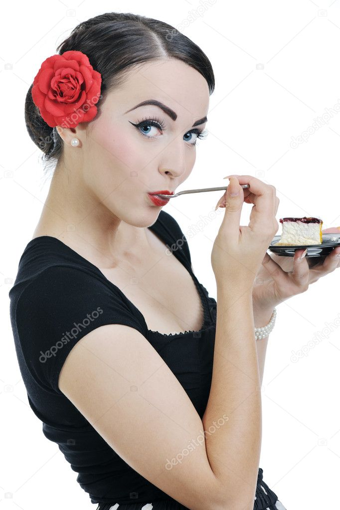 Pretty young happy woman eat cake and posing isolated on white backround in studio — Stock Photo #7992625