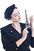 Beautiful young woman with paris symbol eiffel tower — Stock Photo