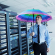 Businessman hold umbrella in server room — Stock Photo