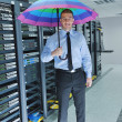 Businessman hold umbrella in server room — Stock Photo #8338404