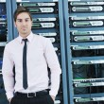 Young it engeneer in datacenter server room — Stock Photo #8338432