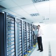Young it engeneer in datacenter server room — Stock Photo #8338446