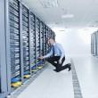 Young it engeneer in datacenter server room — Foto Stock