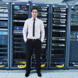 Young it engeneer in datacenter server room — Stock Photo #8338462