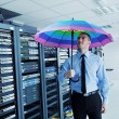Stock Photo: Businessmhold umbrellin server room