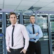 It enineers in network server room — Stock Photo #8338513