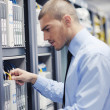 young it engeneer in datacenter server room — Stock Photo #8338536