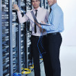 It enineers in network server room — Stock Photo #8338541