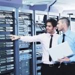It enineers in network server room — Stock Photo #8338549