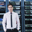 Royalty-Free Stock Photo: Young it engeneer in datacenter server room
