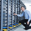 Young it engeneer in datacenter server room — Stock Photo #8338587