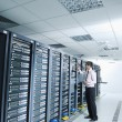 Young it engeneer in datacenter server room — Stock Photo #8338591
