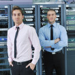 It enineers in network server room — Photo