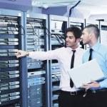 It enineers in network server room — Stock Photo