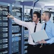 It enineers in network server room — Stock Photo