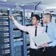 It enineers in network server room — Stock Photo #8338654