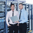 It enineers in network server room - 图库照片