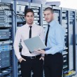 It enineers in network server room — Stock Photo #8338668