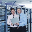 It enineers in network server room — Stock Photo #8338671
