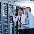 It enineers in network server room — Stock Photo #8338675