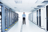 Young it engeneer in datacenter server room — Stock Photo