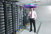 Businessman hold umbrella in server room — Stock Photo