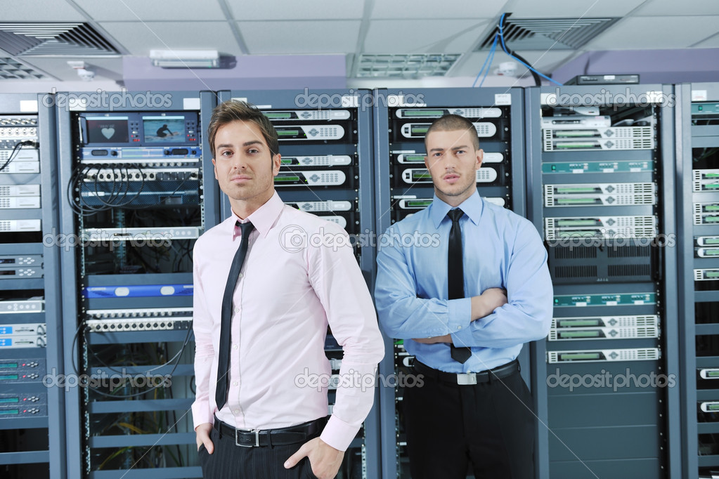 Group of young business it engineer in network server room solving problems and give help and support — Stock Photo #8338540