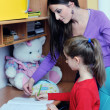 Mom and girl doing homework at home — Stock Photo