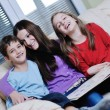 Young mom play with their kids at home and reading book — Stock Photo