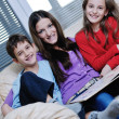 Young mom play with their kids at home and reading book — Stock Photo #8491533