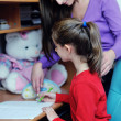 Mom and girl doing homework at home — Stock Photo #8491542