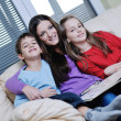 Young mom play with their kids at home and reading book — Foto Stock