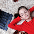 Happy school girl relaxing at home — Stock Photo