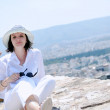 Greek woman on the streets of Oia, Santorini, Greece — Stockfoto