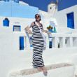 Greek woman on the streets of Oia, Santorini, Greece — Stock Photo