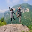 Happy young couple jumping in the air — Stock Photo #8492851