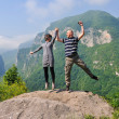 Happy young couple jumping in the air — Stock Photo #8493115