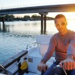 Portrait of happy young man on boat — Foto de Stock
